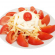 Red tomatoes from above are strewed by cheese — Stock Photo
