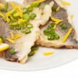 Two pieces of fried fish and lemon segment — Stock Photo