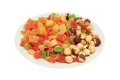 Fried filbert and multi-coloured candied fruits — Stock Photo