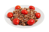 Buckwheat cereal with tomatoes — Stock Photo