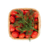 Red tomatoes in a basket — Stockfoto