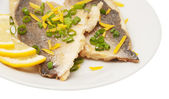 Two pieces of fried fish and lemon segment — Fotografia Stock