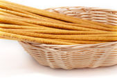 Wheaten sticks lay in a basket — Stock Photo