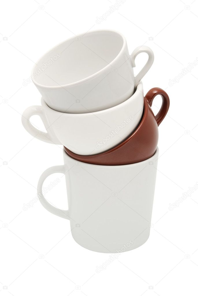 Four different cups are put by a pile one on another. On a white background — Stock Photo #9795279