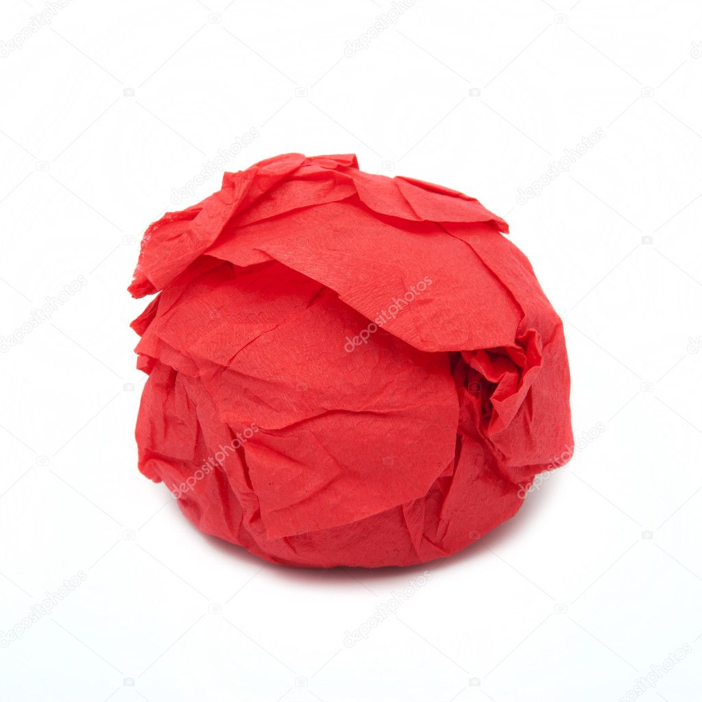 Something round is turned in a red paper — Stock Photo #9795355