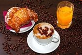 Brioches e cappuccino and jus — Stock Photo