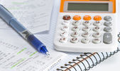 Calculator and notebook — Foto Stock