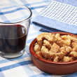 Pork rinds and glass of wine — Stock Photo