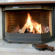 Burning fireplace and bellows — Stock Photo