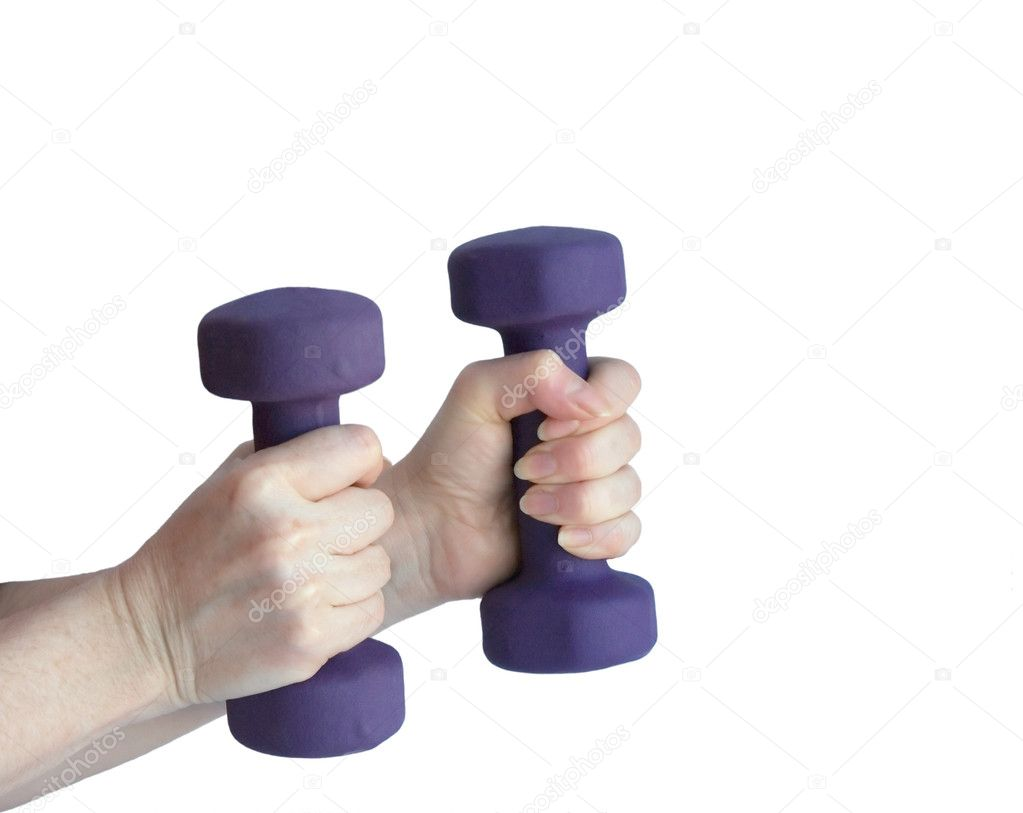 Female hands holding violet dumbbells, on a white background — Stock Photo #9767342