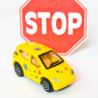 Toy car with road sign stop — Stock Photo