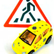 Toy car and road sign — Stock Photo