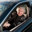 86 year old woman at her home, drivingn her car — Stok fotoğraf