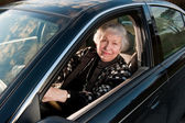 86 year old woman at her home, drivingn her car — Stock Photo