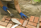 Laying brick walkway — Stock Photo