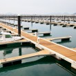 Jetty for mooring boats and yachts — Stock Photo #10732321
