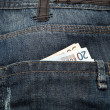 Saved Euros saved in the pocket of the jeans — Stock Photo