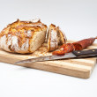 Loaf of bread baked in wood oven — Stock Photo #9764503