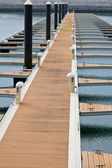Pier in the harbor for berthing of boats — Stock Photo