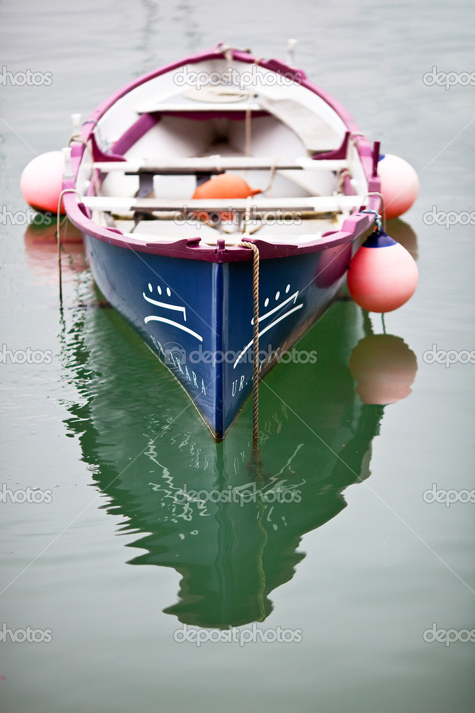 Rowing boat moored in the sea  Stock Photo #9763423