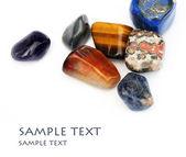 Beautiful precious stones against white background — Stock Photo