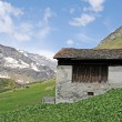 An old stone house in the swiss alps — Stock Photo