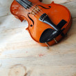 Violin on a wooden table — Stock Photo