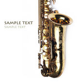 Close-up of a beautiful golden saxophone against white background — Stock Photo
