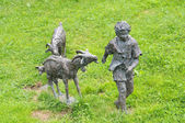 Beautiful sculpture of a shepherd and his goats — Stock Photo