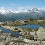 Alpine lake and panorama — Stock Photo