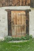 Door of the old house in the swiss alps — Stock Photo