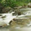Stock Photo: Flowing river (long exposure image)
