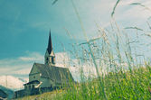Picturesque old church in alpine landscape — Stock Photo