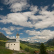 Beautiful old village (soglio) and church in alpine landscape (bregaglia region of switzerland)beautiful old village (soglio) and church in alpine landscape (bregaglia region of switzerland) — Stock Photo #9956334