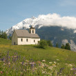 Church in alpine landscape — Stok fotoğraf