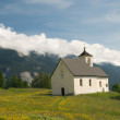 Church in alpine landscape — Stock Photo
