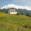 Stock Photo: Church in alpine landscape