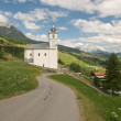 Alpine landscape with church - Foto Stock