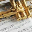 Beautiful golden trumpet on sheet music — Photo