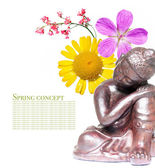 Peaceful buddha and spring flora — Stock Photo