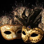 Ornate carnival masks on firework background — Stock Photo