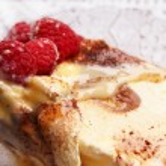 Delicious ice cream tiramisu with raspberries — Stock Photo