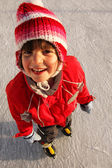 Smiling girl on ice skates — Stockfoto