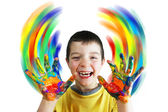 Boy paints color circles by hands — Stock Photo