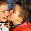 Boy kissing a girl, hearts around — Stock Photo
