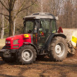 Cleanup at the park by tractor - Stock Photo