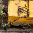 Garbage truck and worker - Stock Photo