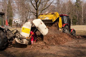 Cleanup at the park by tractor — Stock Photo