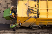 Garbage truck and worker — Stock Photo