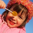 Stock Photo: Girl with lollipop.